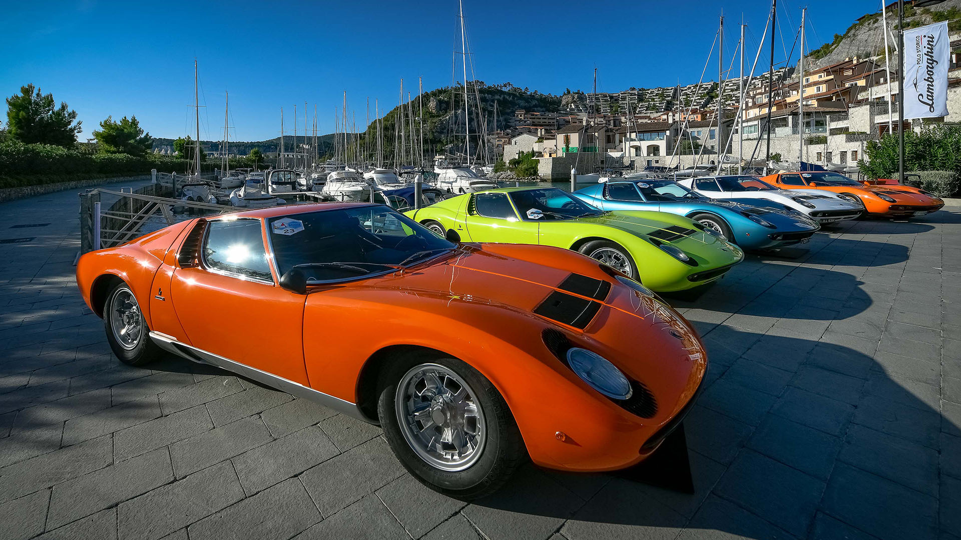 Ferrari 365 GTB parked with other supercars