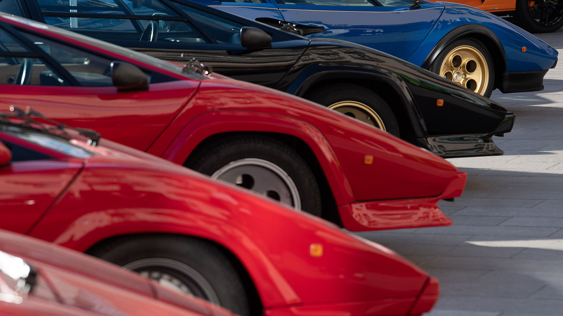 A variety of Lamborghini Countachs parked together