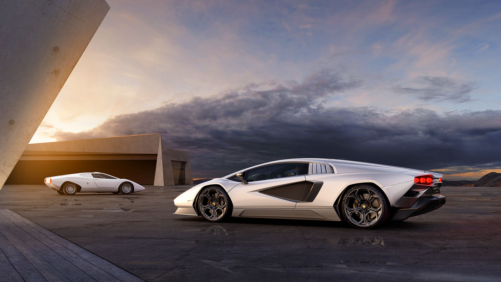 Lamborghini official photo of the new Countach with the old one in the background