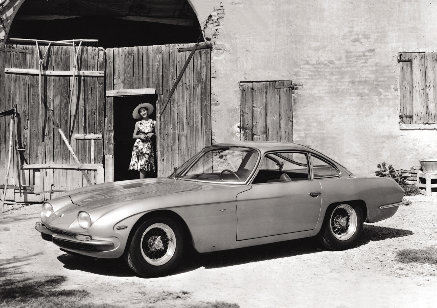 1964 Lamborghini 350 GT parked outside of a building
