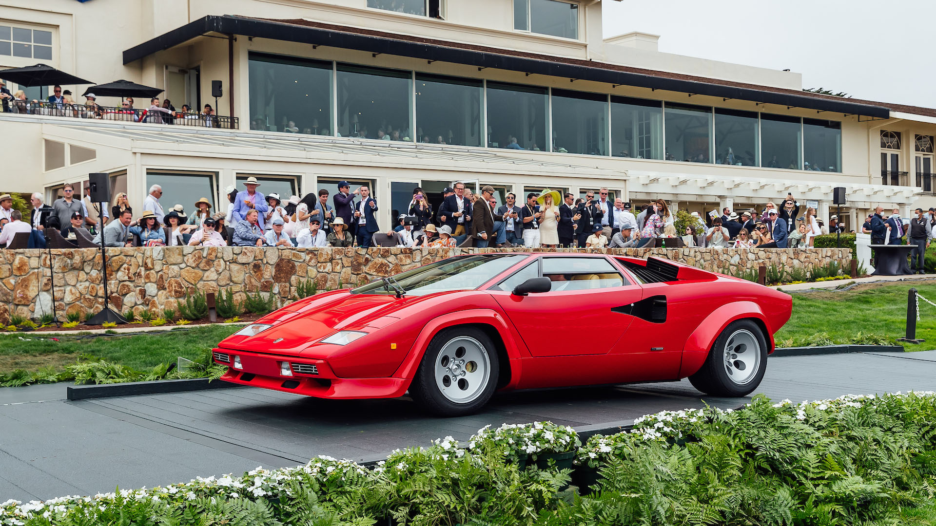 A red Countach at Pebble Beach during Monterey Car Week